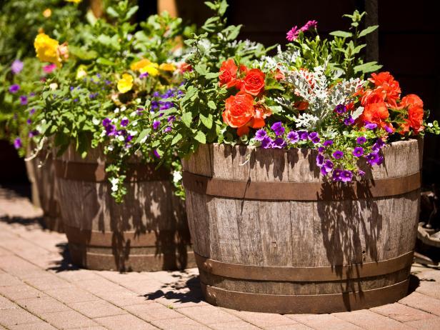 iStock-3777830_barrels-in-garden-with-flowers_s4x3.jpg.rend.hgtvcom.616.462.jpeg