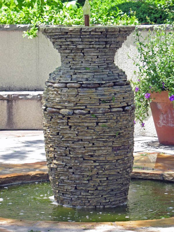 waterfeature_stacked-stone-fountain.jpg.rend.hgtvcom.966.1288