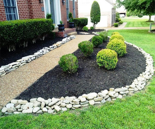 15 wonderful garden edging ideas with pebbles and stones for Decorative stone garden border