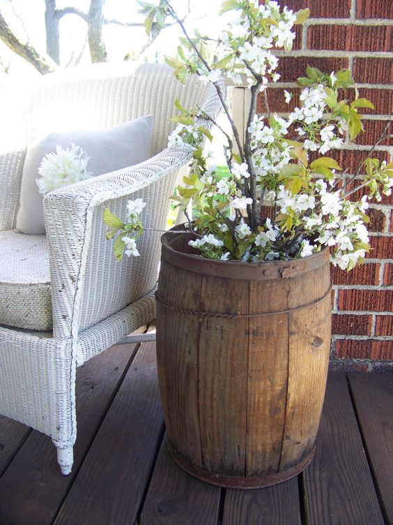 15 smart ways to incorporate wooden barrels in your yard for Wooden barrel planter ideas