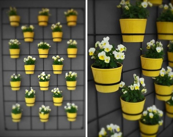 vertical-garden-planter-ideas-metal-construction-yellow-flower-boxes