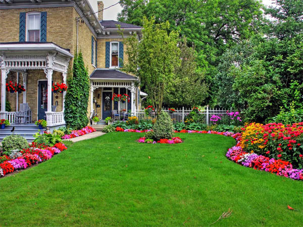 Bright Landscaping And Double Porches