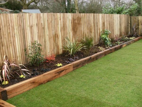 17 fascinating wooden garden edging ideas you must see for Wooden garden edging
