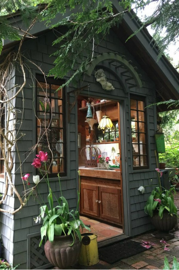 15 whimsical charming gardens shed designs the art in life for Funky garden accessories